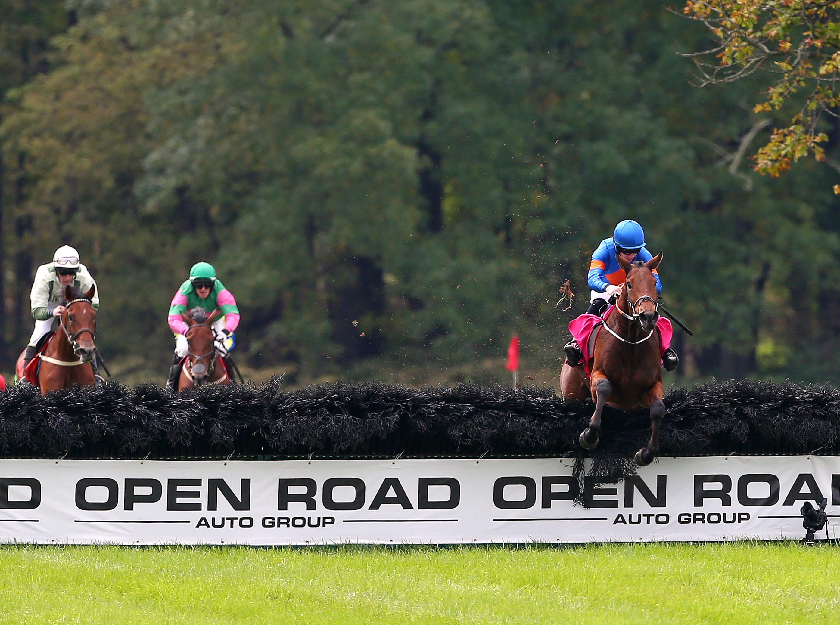Caldbeck ridden by jockey Jack W. Kennedy clears the final jump on his way to victory in the Gladstone during the 98th running of the Far Hills Race Meeting at Moorland Farm in Far Hills, N.J. on Saturday, Oct. 20, 2015. Photo by Rich Schultz/ HNT