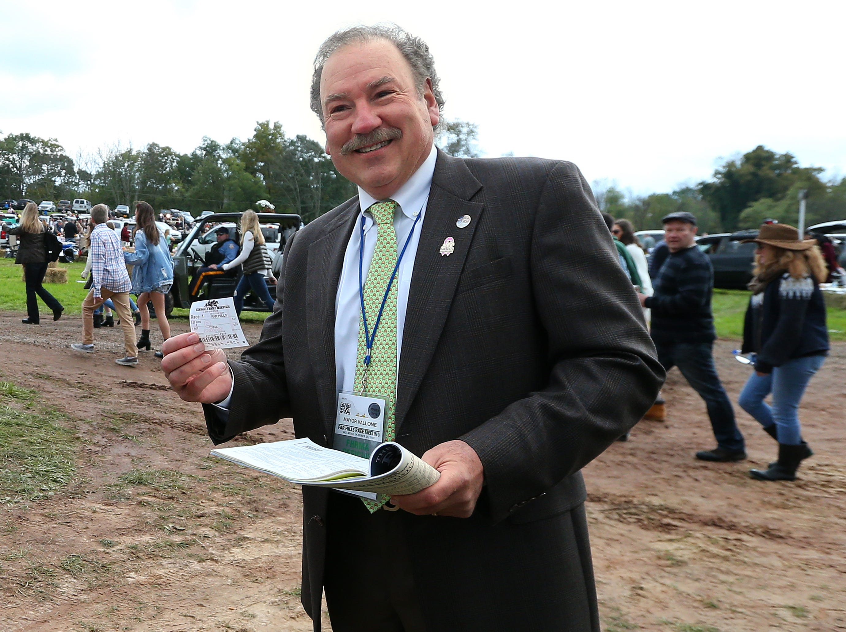 Mayor of Far Hills, New Jersey, Paul Vallone, shows off his ticket after placing the first official bet during the 98th running of the Far Hills Race Meteing at Moorland Farm in Far Hills, N.J. on Saturday, Oct. 20, 2015. Photo by Rich Schultz/ HNT