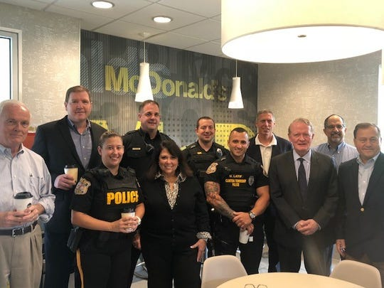 Officers from the Clinton Township Police Department, Assemblyman John DiMaio, Congressman Leonard Lance, Senator Mike Doherty and McDonald's Owner/Operators Diane and Philip Koury celebrated National Coffee with a Cop Day at the Center Street restaurant on Tuesday, Oct. 2.