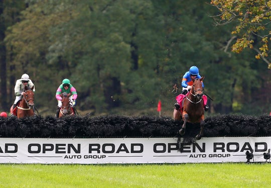 Caldbeck ridden by jockey Jack W. Kennedy clears the final jump on his way to victory in the Gladstone during the 98th running of the Far Hills Race Meeting at Moorland Farm in Far Hills, N.J. on Saturday, Oct. 20, 2018.