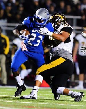 Piscataway's Jordin Martell (76) tackles Sayreville's Zuriel Wright during the first half on Friday, Oct. 19, 2018.