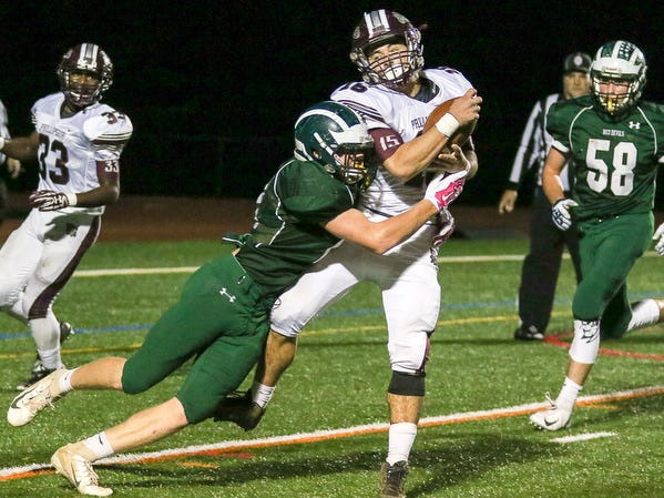 Ridge's Brendan Bell (left) tackles Phillipsburg's Mark Zgoda on Friday, Oct. 19, 2018.