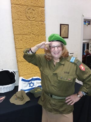 Barbara Pollak, a volunteer for the IDF, will deliver scarves to the Lone Soldiers of Israel.
