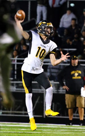Piscataway quarterback Joseph Hatcher throws a pass during the first half against Sayreville on Friday, Oct. 19, 2018.