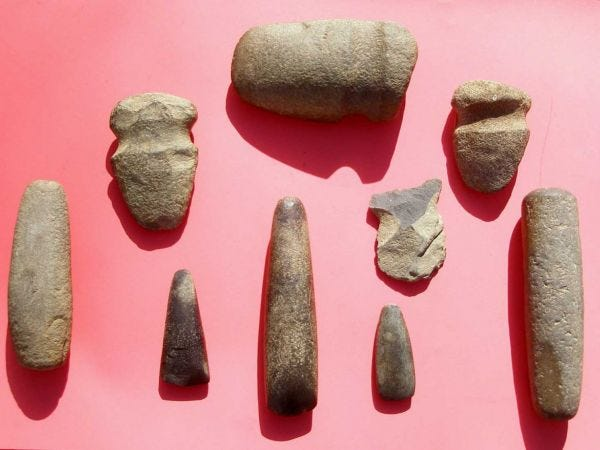 Lenni Lenape grinding stones, axe heads, celts and hoe blade.