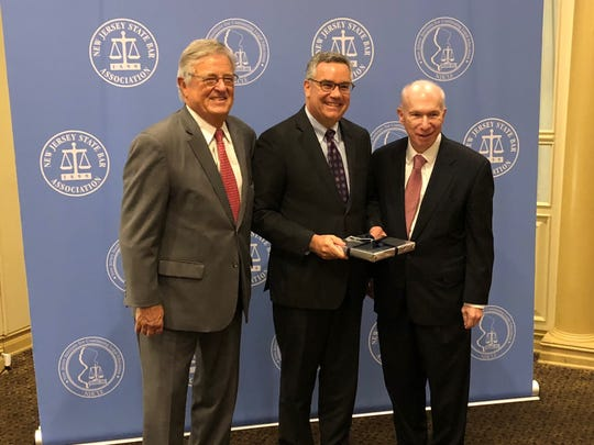 Jay Lavroff, a partner with Westfield-based law firm Lindabury, McCormick, Estabrook & Cooper, P.C., was honored as the Union County Bar Association's Professional Lawyer of the Year at the NJ Commission on Professionalism in the Law annual awards luncheon on Oct. 11 at Pines Manor in Edison. (Leftto right): Former Chief Judge of the U.S. District Court for the District of New Jersey Jack Bissell, Jay Lavroff, and New Jersey Supreme Court Justice Barry Albin.