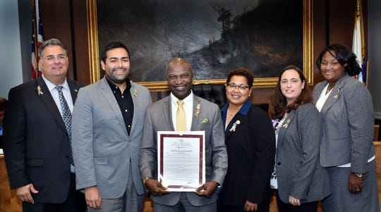 Union County Freeholder Chairman Sergio Granados and Freeholders Alexander Mirabella and Rebecca Williams presented a resolution to Plainfield Mayor Adrian Mapp proclaiming Thursday, Oct.11, 2018 as Coming Out Day throughout the County of Union and further declared Union County as a safe space for LGBTQ individuals. They were joined by Union County Department of Human Services Director Debbie-Ann Anderson and Office of LGBTQ Services Coordinator Danni Newbury. The presentation took place during the during the Freeholders' mobile meeting in Plainfield.