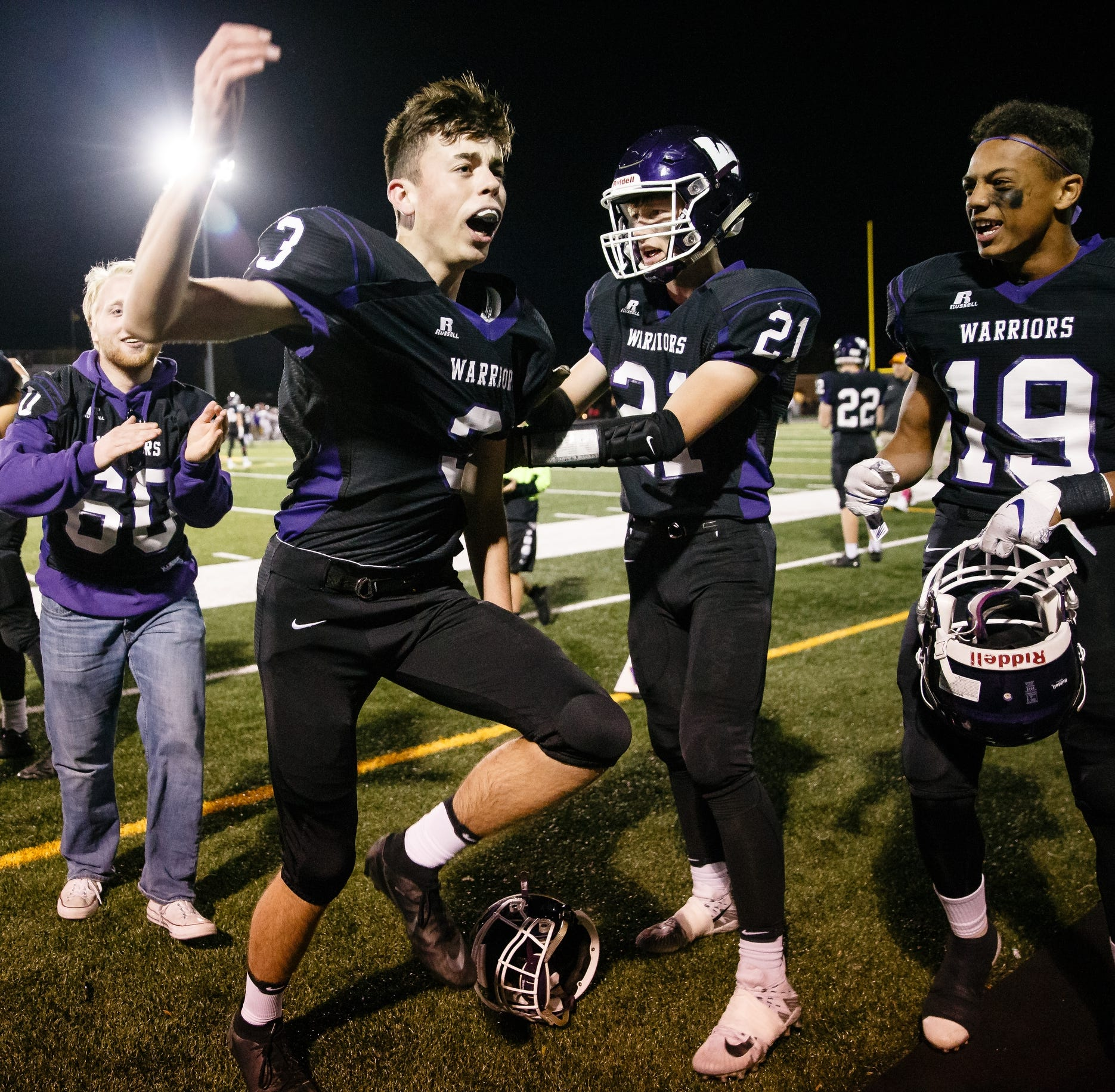 Waukee's Cade Tjaden, center, celebrates after kicking the game winning field goal with 22.4 seconds left to put Waukee up 31-30 over Johnston during their football game at Waukee Stadium on Friday, Oct. 19, 2018, in Waukee.