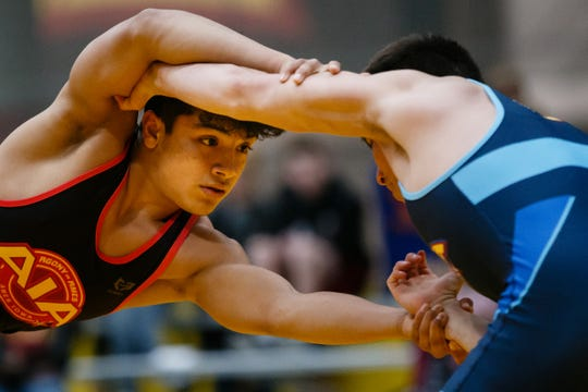 Jesse Ybarra, left, takes on Jeremiah Reno, right, during their 126 pound match at the Agony in Ames High School Showcase on Saturday, Oct. 20, 2018, in Ames. Ybarra would go on to win 5-3.