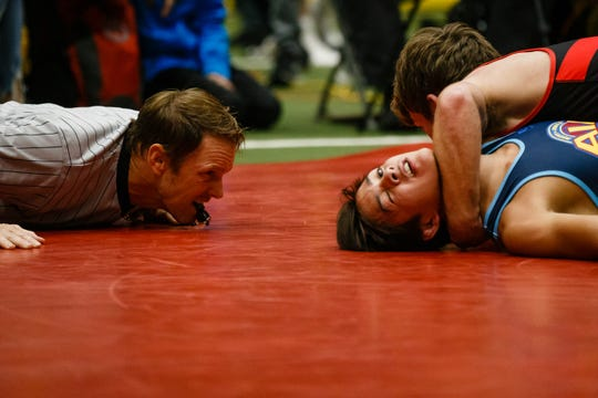 Aden Reeves, red, wrestles Matt Ramos, blue during their 120 pound match at the Agony in Ames High School Showcase on Saturday, Oct. 20, 2018, in Ames. Reeves would go on to win by a fall.