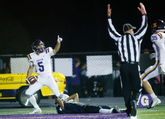 After catching a pass, Johnston's Anthony Coleman (5) runs in for a 38-yard touchdown during their football game at Waukee Stadium on Friday, Oct. 19, 2018, in Waukee.