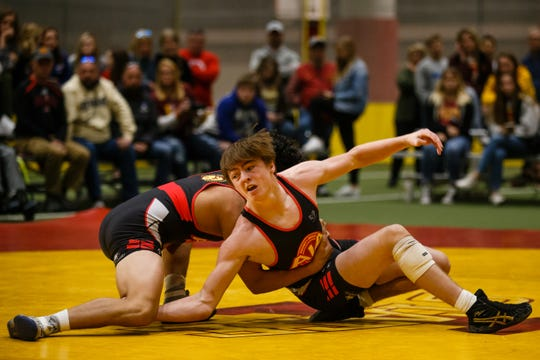 Caleb Rathjen, right, wrestles Jesse Ybarra, left, during their 126 pound match at the Agony in Ames High School Showcase on Saturday, Oct. 20, 2018, in Ames. Ybarra would go on to win 3-1.