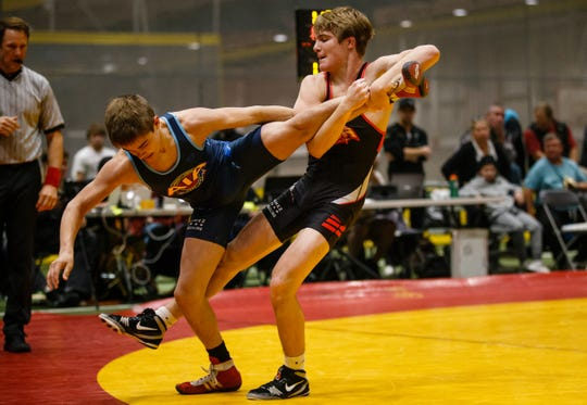 Cullan Schriever, red, competed at the Agony in Ames last weekend. The Mason City junior and Iowa wrestling commit then placed sixth at the Super 32 Challenge this past weekend.