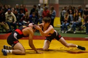 Ankeny's Caleb Rathjen, right, wrestled at the Agony in Ames during the preseason. Rathjen beat Valley's Nick Oldham, a defending state champion, in the finals of the Jack Mendenhall Invitational this weekend in Ames.