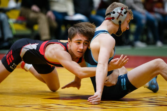 Drake Ayala, left, takes on Braxton Brown, right, during their 106 pound match at the Agony in Ames High School Showcase on Saturday, Oct. 20, 2018, in Ames. Ayala would go on to win 9-5.