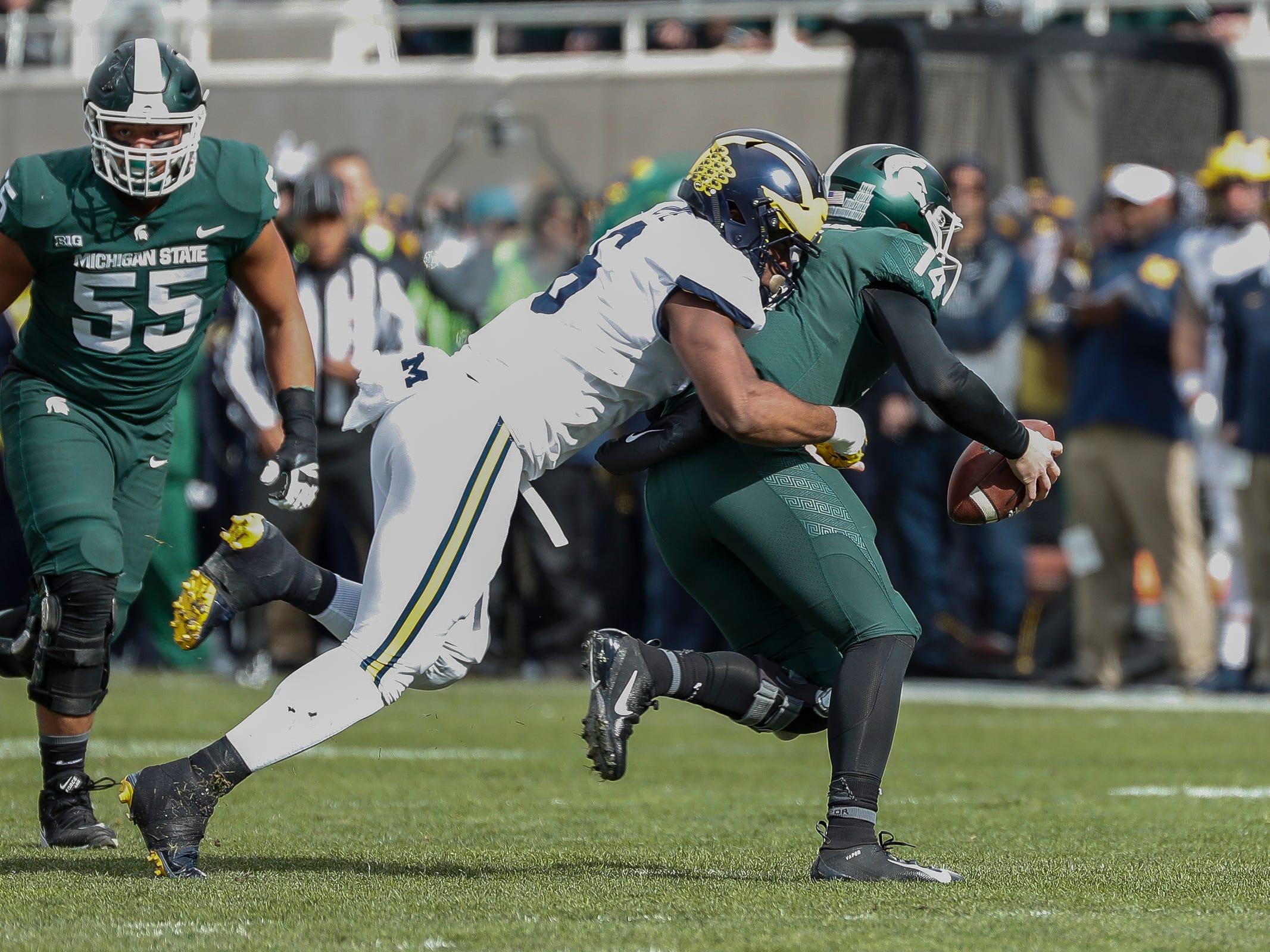 Michigan linebacker Josh Uche sacks Michigan State quarterback Brian Lewerke during the first half at Spartan Stadium on Saturday, Oct. 20, 2018.