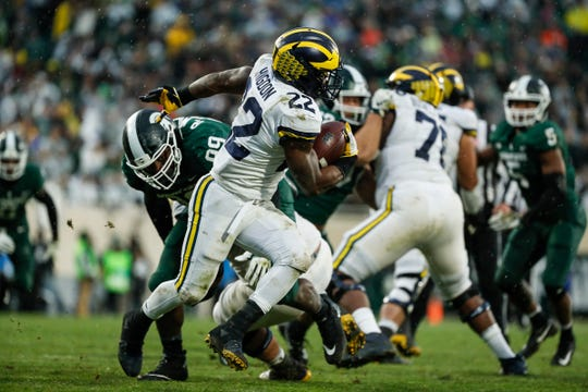 Michigan running back Karan Higdon runs against Michigan State during the second half at Spartan Stadium in East Lansing, Saturday, Oct. 20, 2018.
