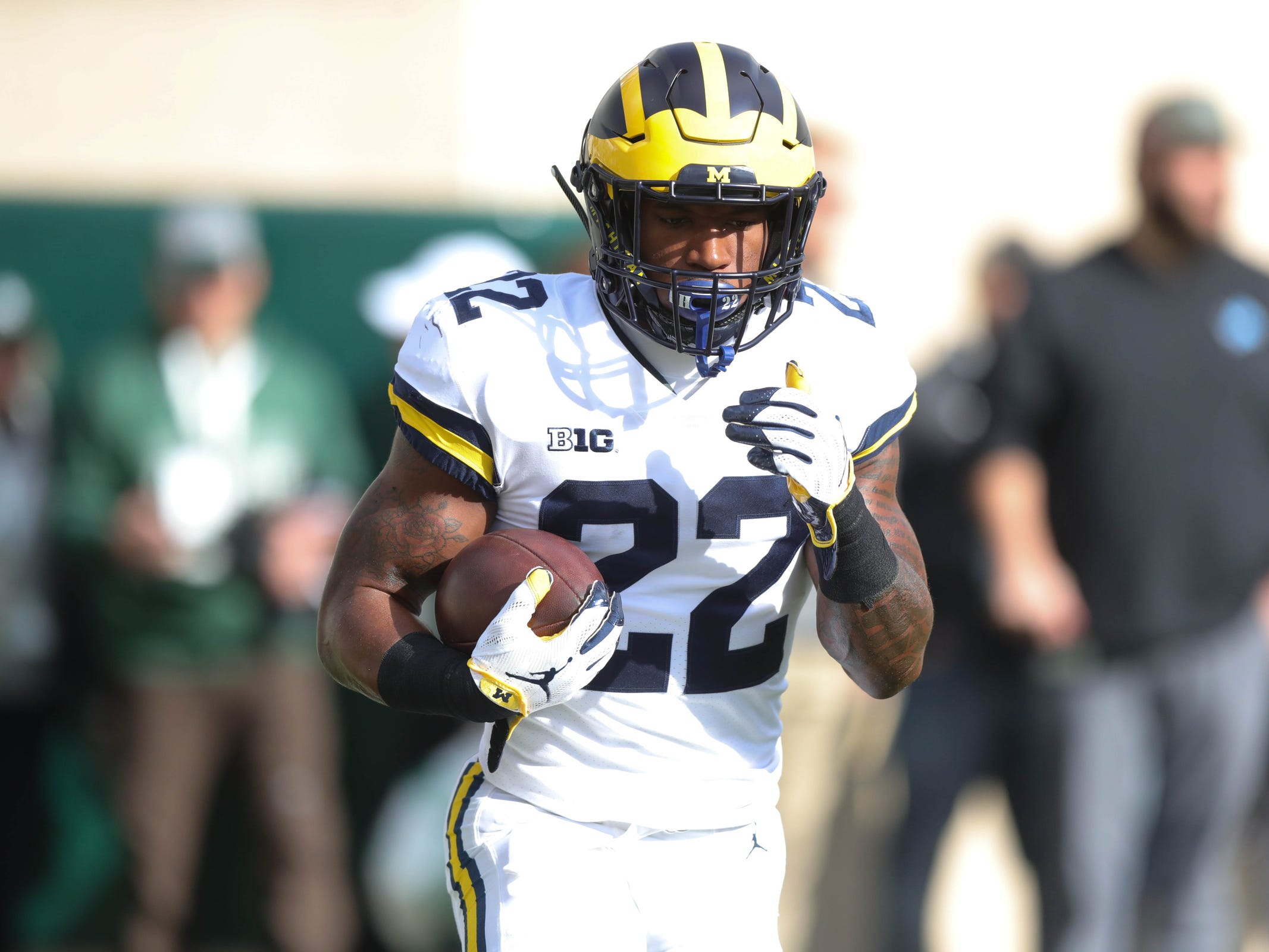 Michigan's Karan Higdon warms up before action against Michigan State on Saturday, Oct. 20, 2018, at Spartan Stadium in East Lansing, Mich.