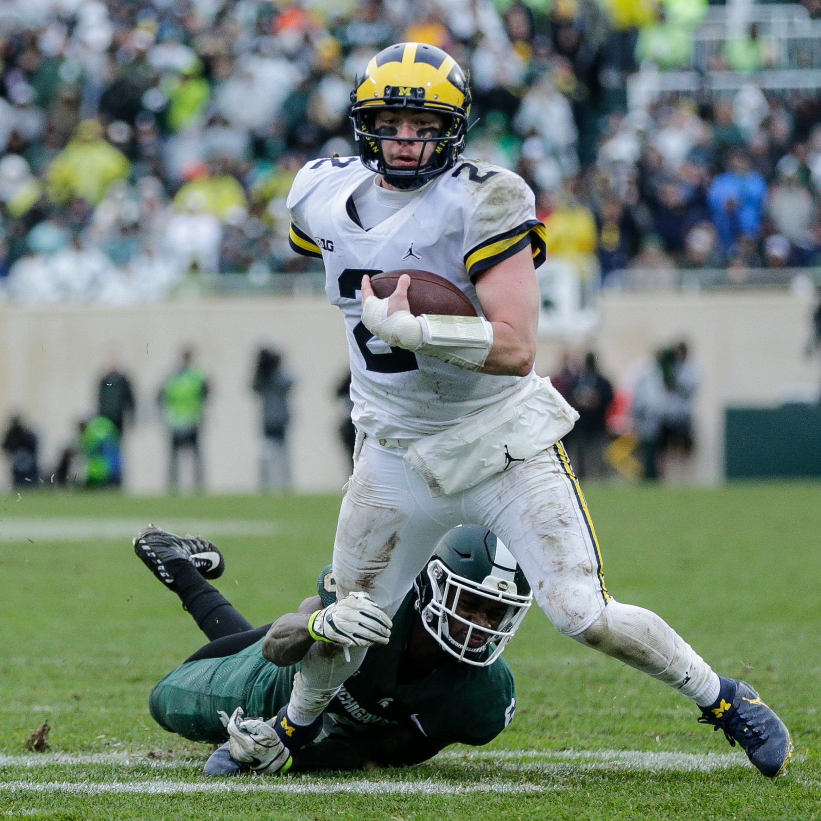 Michigan quarterback Shea Patterson runs against Michigan State during the second half at Spartan Stadium in East Lansing, Saturday, Oct. 20, 2018.