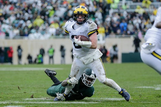 Shea Patterson runs against Michigan State during the second half.