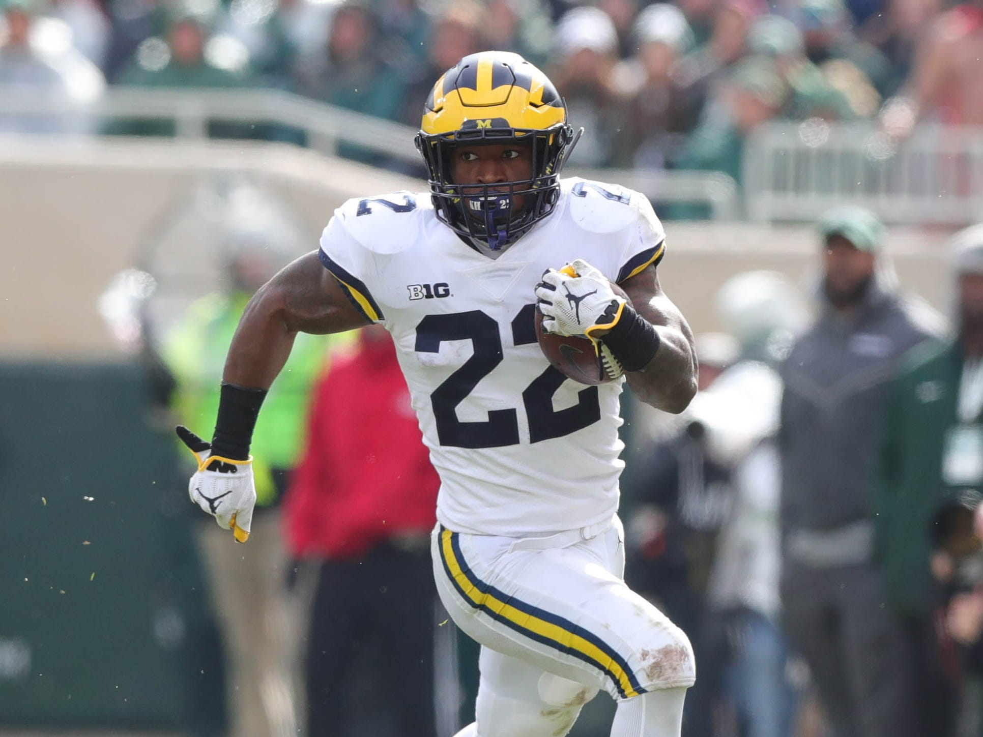 Michigan running back Karan Higdon runs for a first down against Michigan State during the first half in Spartan Stadium on Saturday, Oct. 20, 2018.