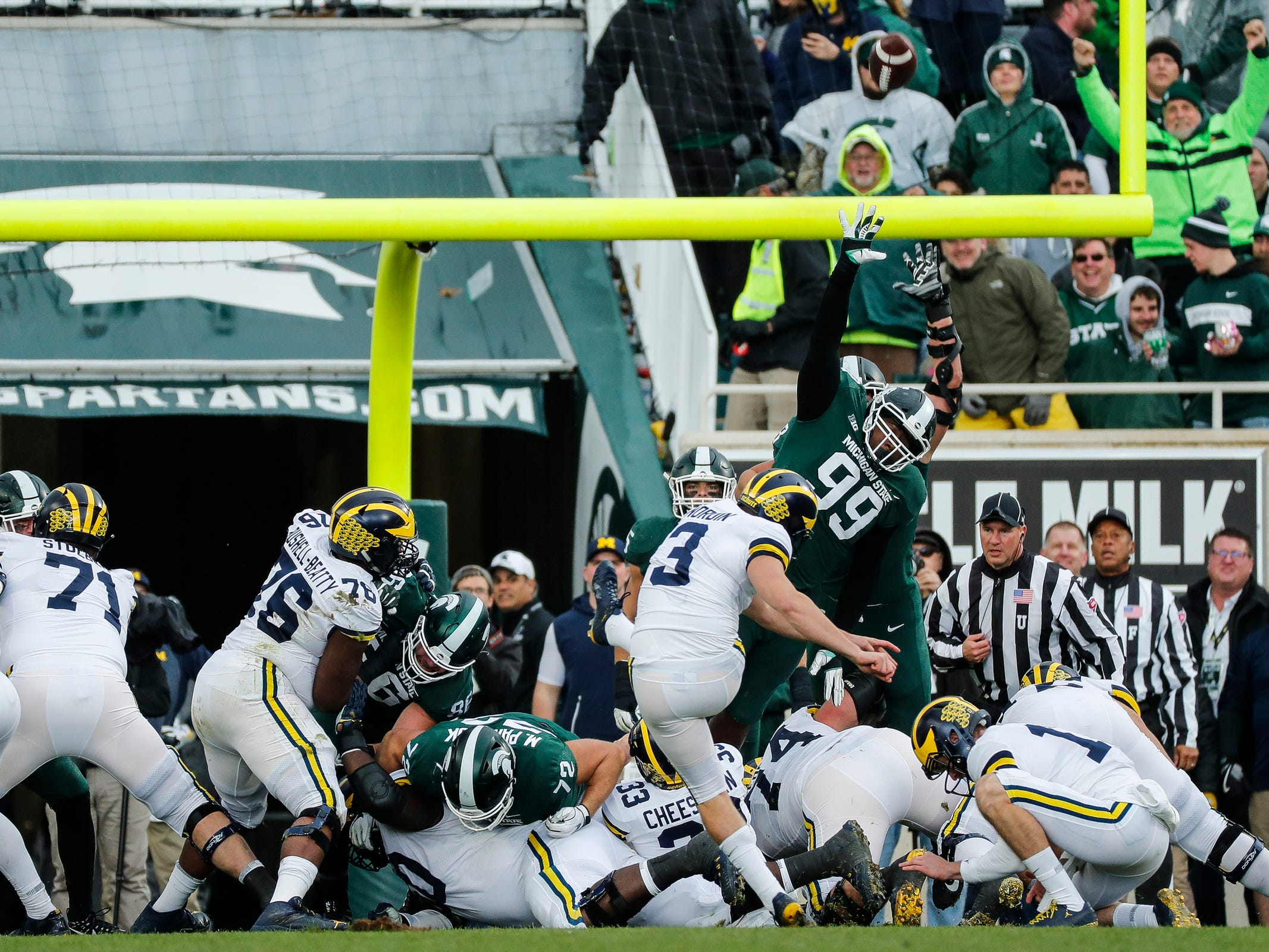 Michigan State defensive tackle Raequan Williams (99) tries to block an extra point attempt from Michigan kicker Quinn Nordin during the first half at Spartan Stadium in East Lansing, Saturday, Oct. 20, 2018.