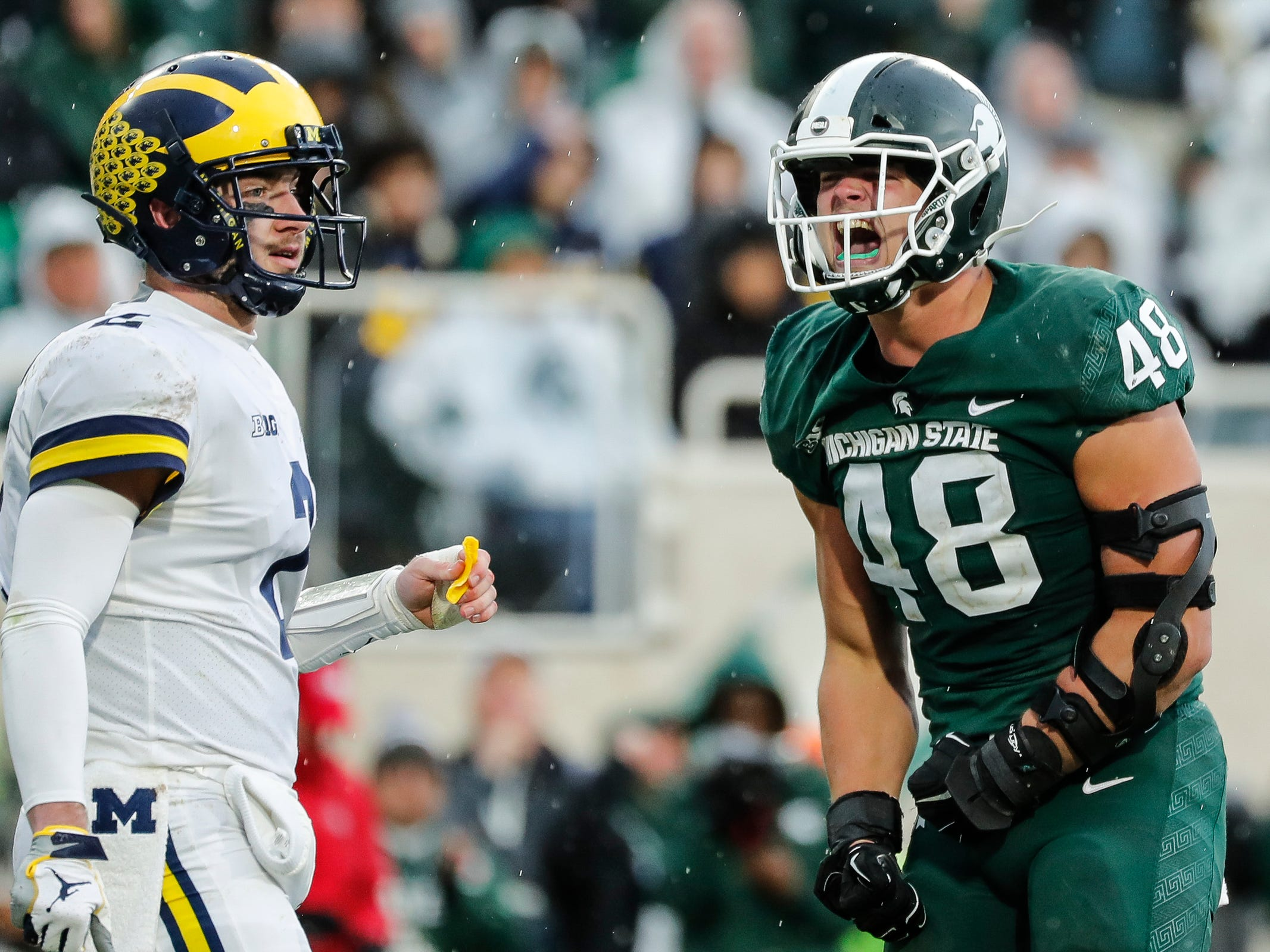 Michigan State defensive end Kenny Willekes celebrates a play against Michigan quarterback Shea Patterson during the second half at Spartan Stadium in East Lansing, Saturday, Oct. 20, 2018.