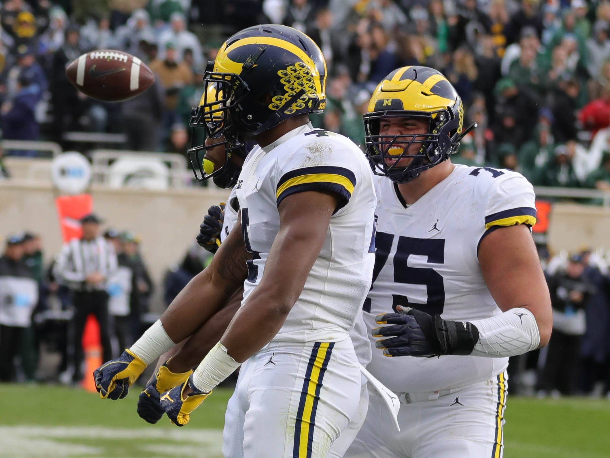 Michigan wide receiver Nico Collins celebrates his touchdown against Michigan State defensive back Tre Person during the first half in Spartan Stadium on Saturday, Oct. 20, 2018.