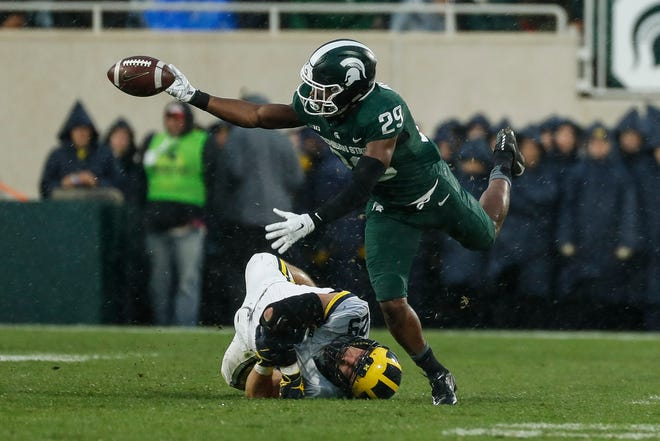Michigan State cornerback Shakur Brown fumbles the ball on a punt return during the second half against Michigan at Spartan Stadium in East Lansing, Saturday, Oct. 20, 2018.