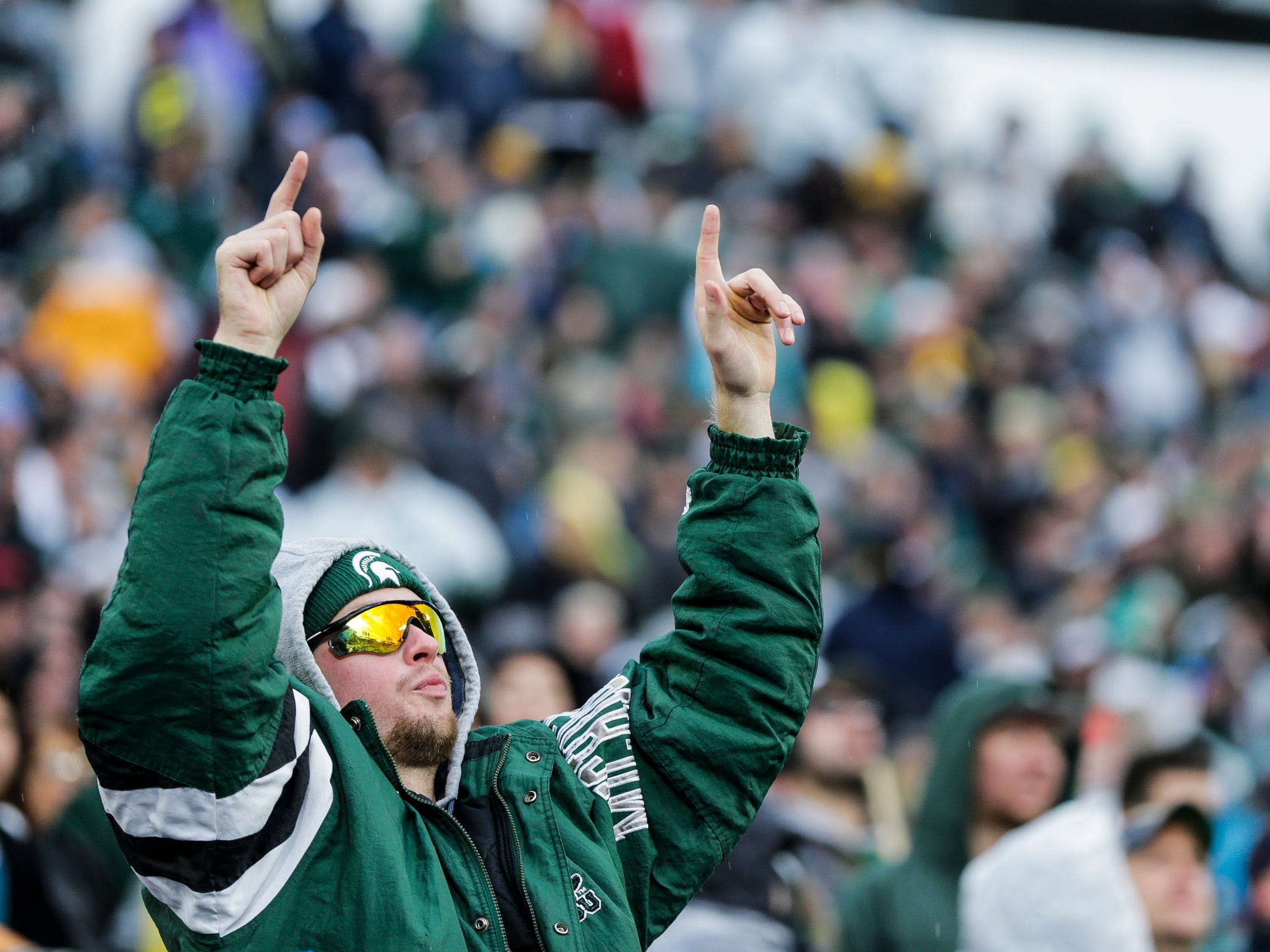 A Michigan State fan cheers for the Spartans during the second half against Michigan at Spartan Stadium in East Lansing, Saturday, Oct. 20, 2018.