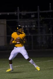 King quarterback Dequan Finn, 5, lines up a pass during the city championship against Cass Tech at Renaissance High School in Detroit on Friday, Oct. 19, 2018.