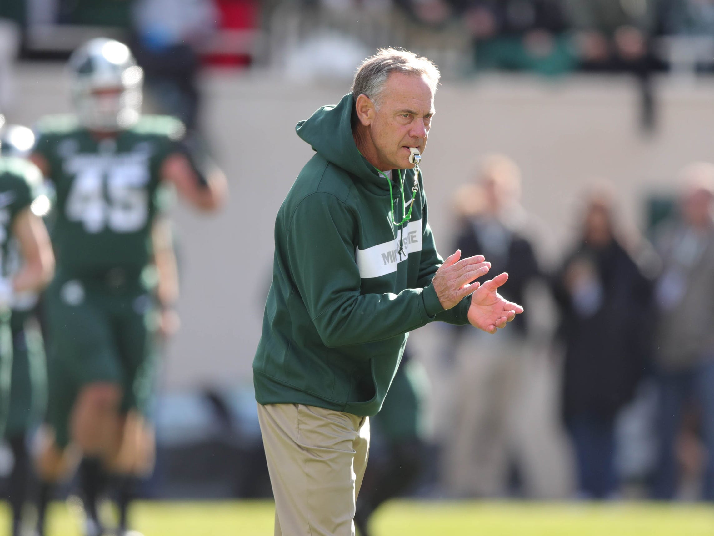 Michigan State head coach Mark Dantonio watches his team warm up before action against Michigan on Saturday, Oct. 20, 2018, at Spartan Stadium in East Lansing, Mich.