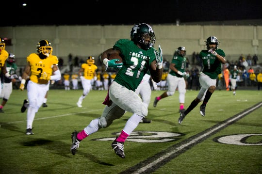 Cass Tech's Lewis Nichols, 21, runs the ball up the field for a touchdown during the city championship against Cass Tech at Renaissance High School in Detroit on Friday, Oct. 19, 2018. Cass Tech won 42-8.
