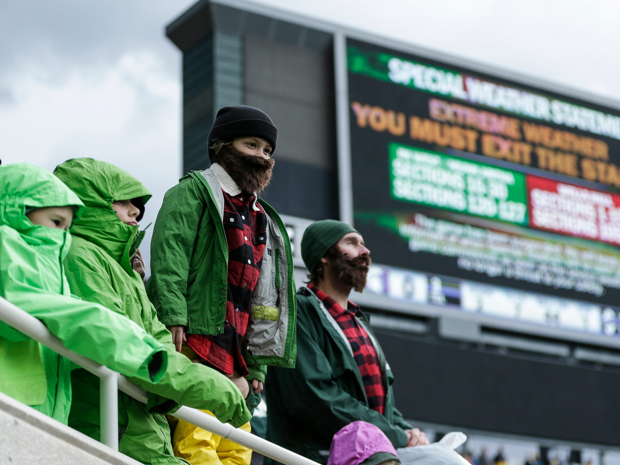 Fans evacuated from Spartan Stadium in the first quarter of the Michigan-Michigan State game due to weather delay on Saturday, Oct. 20, 2018.