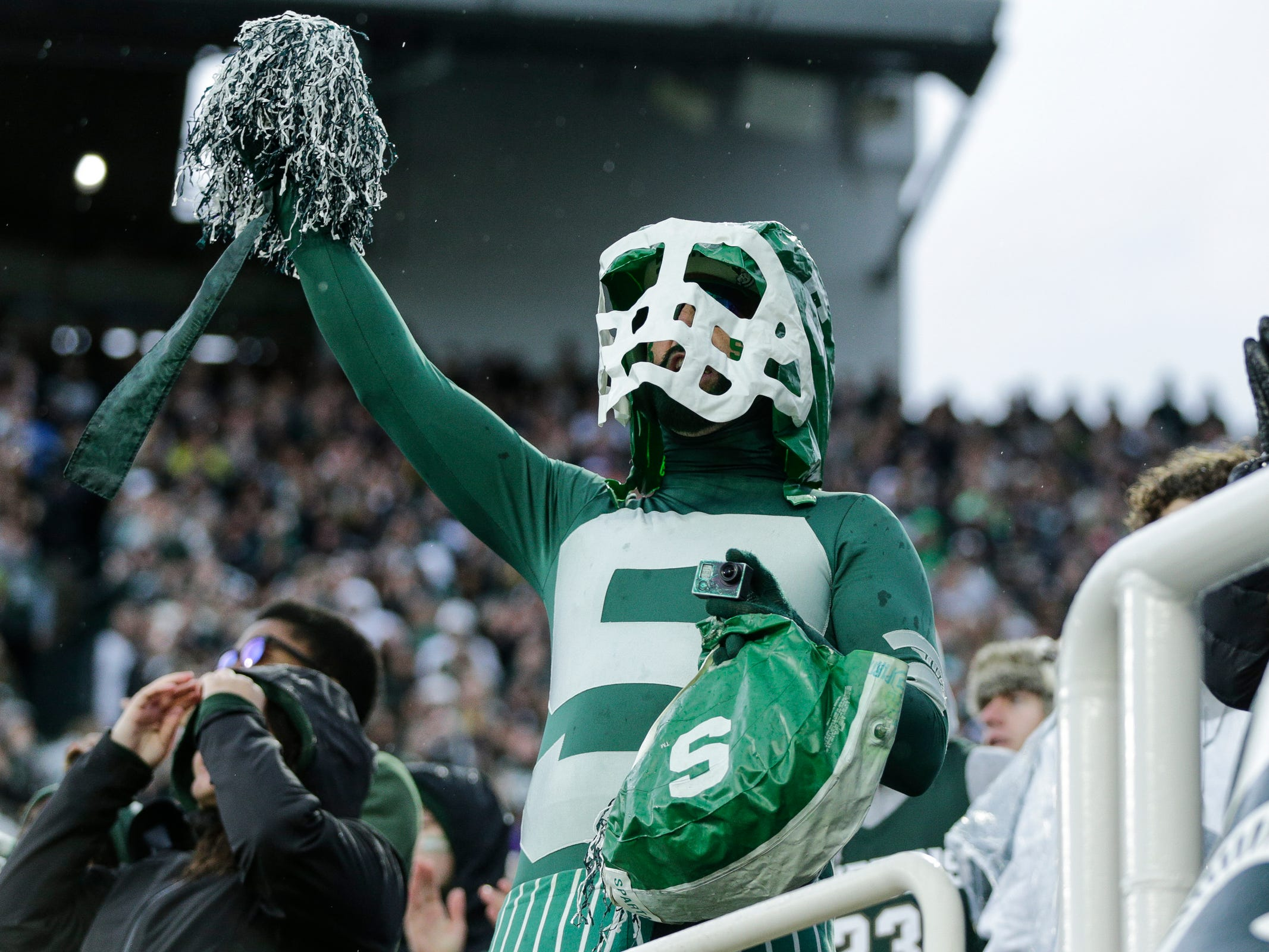 Michigan State fan Johnny Spirit celebrates a touchdown against Michigan during the second half at Spartan Stadium in East Lansing, Saturday, Oct. 20, 2018.