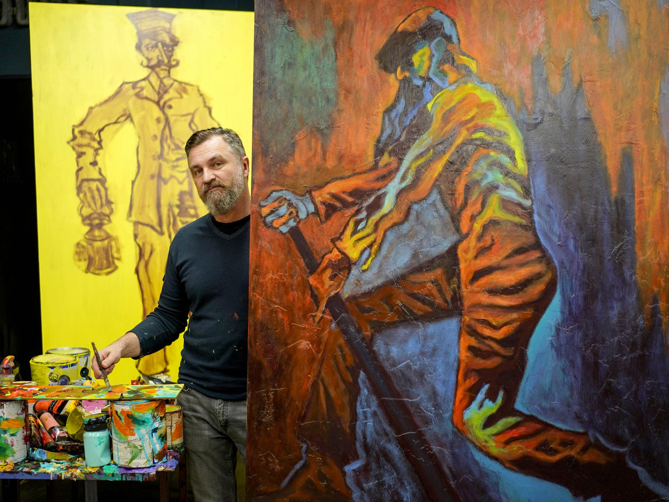 Artist Tony Roko next to his paintings at his studio in Plymouth on Friday, October 12, 2018.