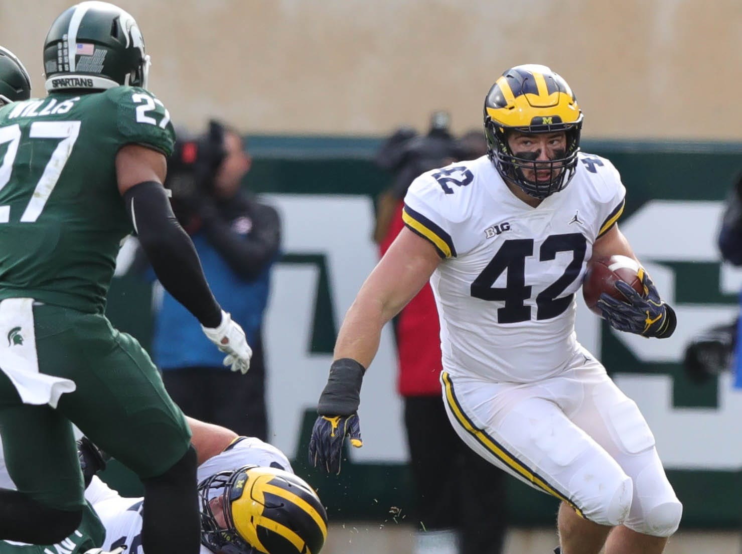 Michigan's Ben mason runs the ball against Michigan State during the first half in Spartan Stadium on Saturday, Oct. 20, 2018.