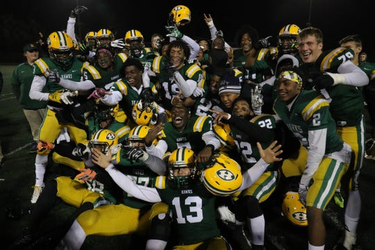 Farmington Hills Harrison players celebrate after the win against Farmington, Friday, October 19, 2018 in Farmington Hills.