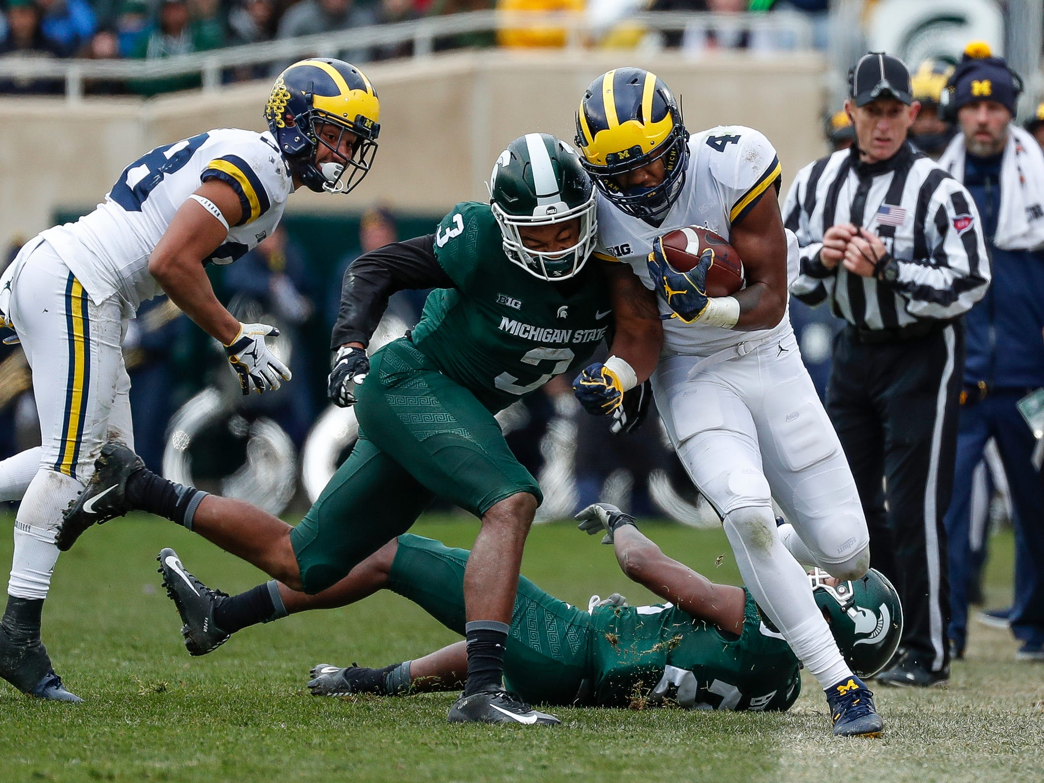 Michigan's Nico Collins is pushed out by Michigan State's Xavier Henderson (3)  during the second half at Spartan Stadium in East Lansing, Saturday, Oct. 20, 2018.