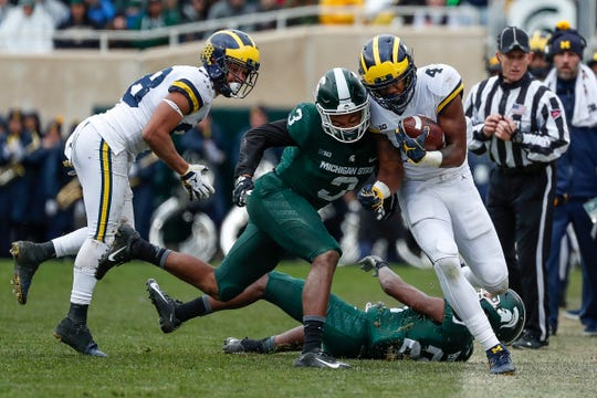 Michigan State safety Xavier Henderson (3), here pushing Michigan's Nico Collins out of bounds, played in all 12 games for the Spartans this season as a true freshman.