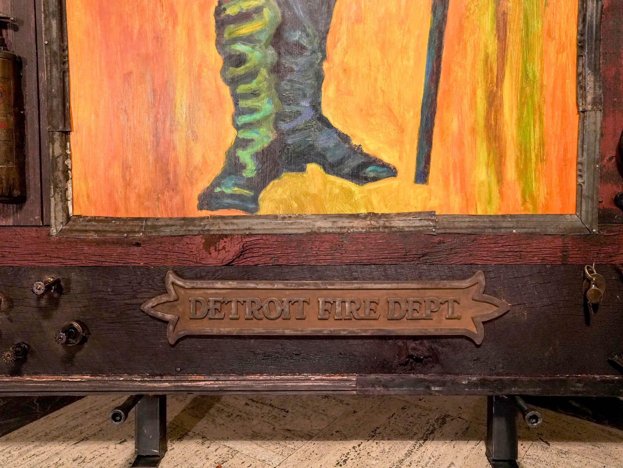 "Old fire department objects are incorporated into the frame of the painting titled ""The Commissioner""  by artist Tony Roko on display at the Detroit Foundation Hotel in downtown Detroit on Friday, October 12, 2018."