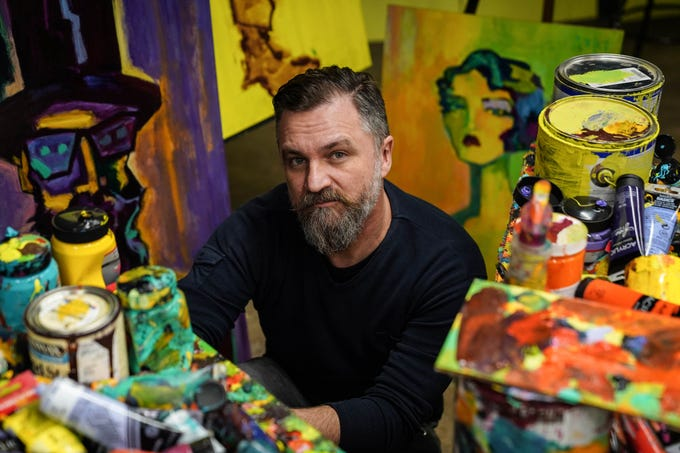 Artist Tony Roko in his studio in Plymouth on Friday, October 12, 2018. Roko got his start on the Ford Assembly line and has painted murals for Ford factories and will have a piece featured in Ford's renovation of the former Michigan Central Station in Detroit's Corktown neighborhood.