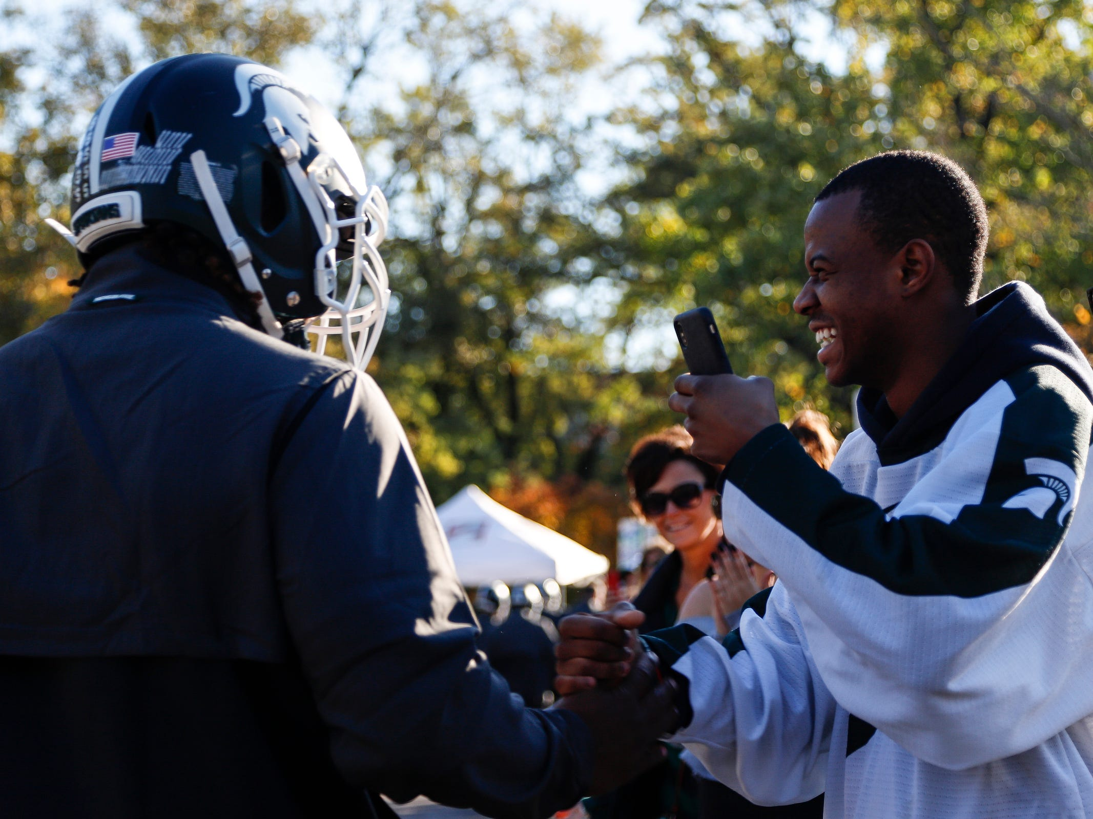 Keante Pendleton, right, shakes hands with his brother, Michigan State defensive tackle Raequan Williams, outside of the Spartan Stadium in East Lansing before the Michigan game on Sat., October 20, 2018.