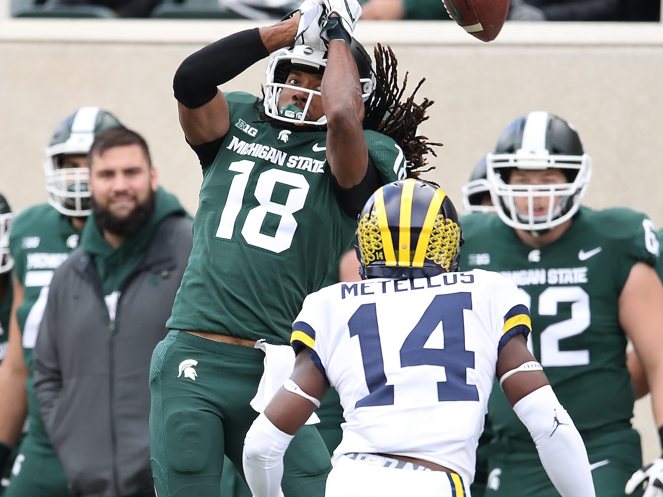 1052610164.jpg EAST LANSING, MI - OCTOBER 20: Felton Davis III #18 of the Michigan State Spartans can't make a first quarter catch next to Josh Metellus #14 of the Michigan Wolverines at Spartan Stadium on October 20, 2018 in East Lansing, Michigan. (Photo by Gregory Shamus/Getty Images)