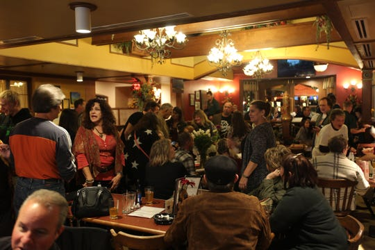 "Guests mingle at an album-release party for Greta Van Fleet's ""Anthem of the Peaceful Army"" in Frankenmuth, Mich., on Oct. 19, 2018."