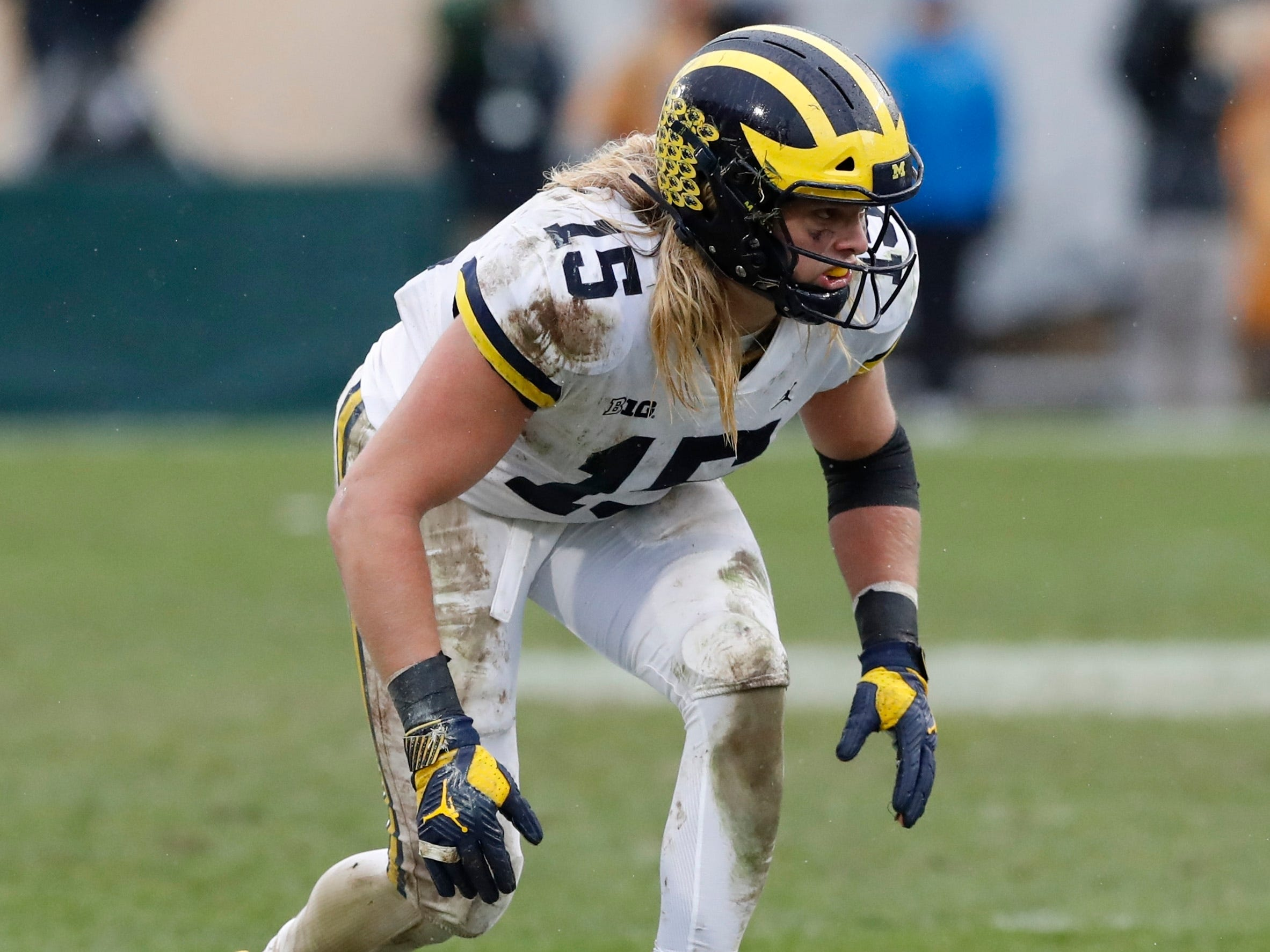 Michigan defensive lineman Chase Winovich prepares to rush the line during the second half of an NCAA college football game against Michigan State , Saturday, Oct. 20, 2018, in East Lansing, Mich.
