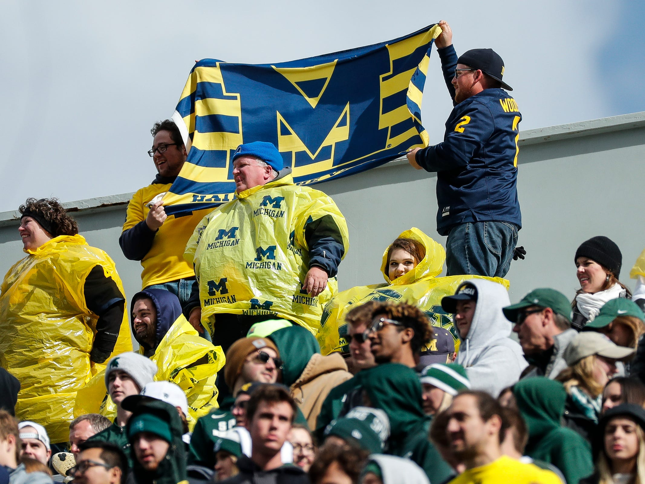 Michigan fans wave a flag during the first half at Spartan Stadium in East Lansing, Saturday, Oct. 20, 2018.