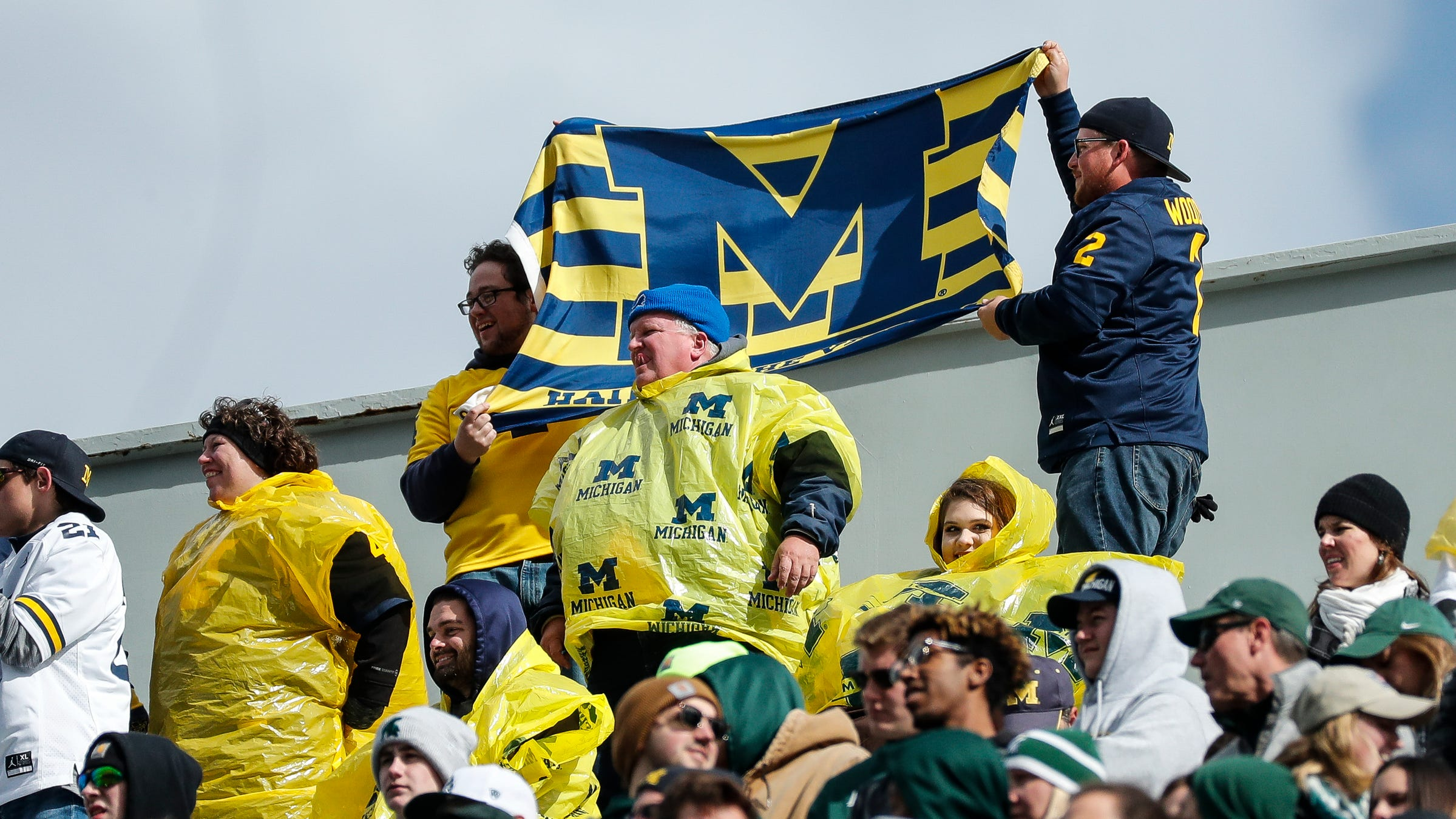 Michigan fans wave a flag during the first half...
