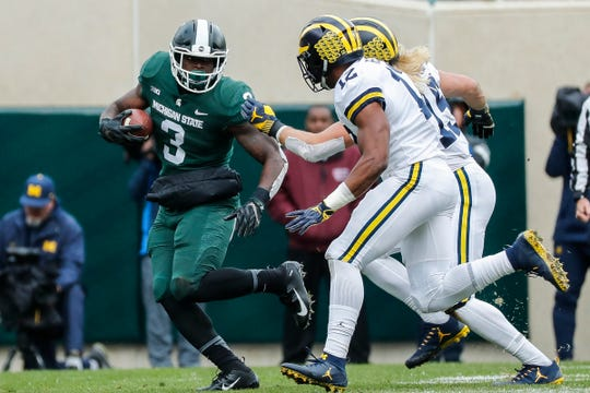 Michigan State running back LJ Scott runs against Michigan during the first half at Spartan Stadium in East Lansing, Saturday, Oct. 20, 2018.