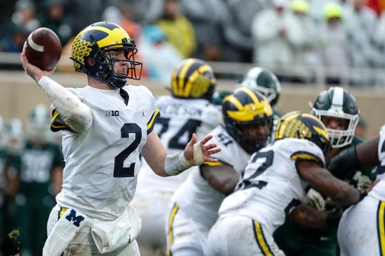Michigan quarterback Shea Patterson passes against Michigan State during the second half at Spartan Stadium in East Lansing, Saturday, Oct. 20, 2018.